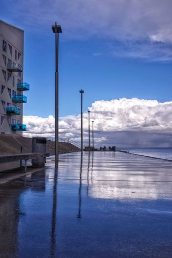 After rain Denmark Shower Rain Clouds Sky Concrete Reflection_collection Reflection Aarhus, Denmark Water Sky Reflection Cloud - Sky Nature No People Blue Tranquility Outdoors Street Wet Street Light Waterfront Day Beauty In Nature Tranquil Scene Scenics - Nature Built Structure
