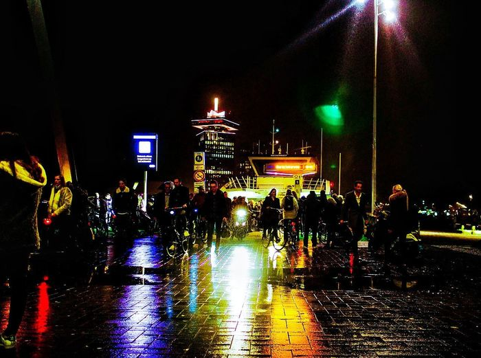 Night Illuminated Large Group Of People Nightlife People Outdoors City Architecture Crowd Sky City Shadows And Light Streetphotography Real People Shadow Raindrops Walking Rain Wet Ferry Boat Ferry Passengers Reflection Photography Adamtoren