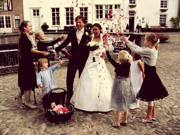 Happily Married , Children throwing Roses Petals with Joy .