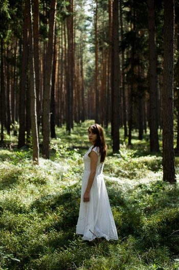 Abundance Beauty In Nature Branch Casual Clothing Day Dress Forest Growth Nature Non-urban Scene Person Remote Scenics Standing Tourism Tourist Tranquil Scene Tranquility Tree People And Places Vacations White WoodLand Young Adult Young Women