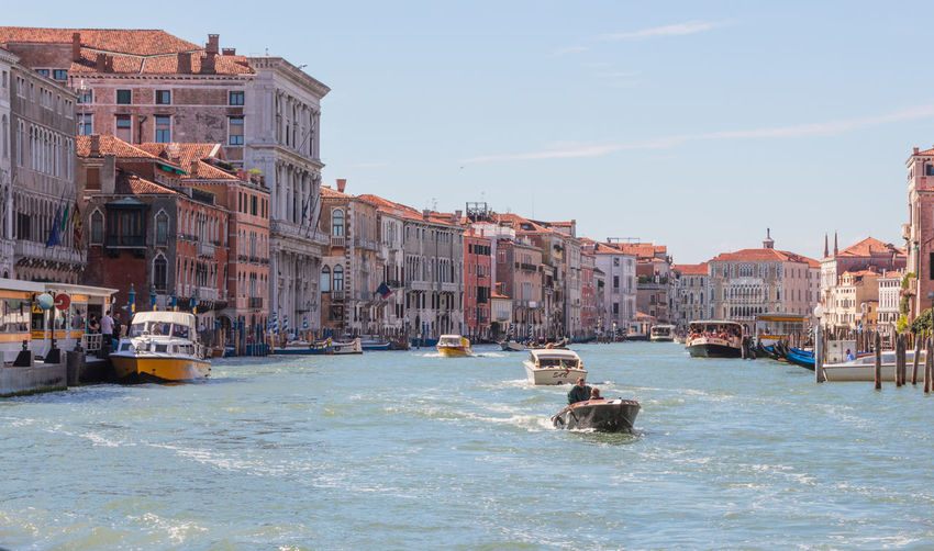 Venice, Italy - September 28, 2015 : Water channels of Venice city. Facades of residential buildings overlooking the Grand Canal in Venice, Italy. Architecture Building Canal City Cityscape Day Destination Europe Fasade Heritage Historic Holiday House Italy Landmark Old Outdoors Romantic Sea Tourism Travel Vacation Venice View Water