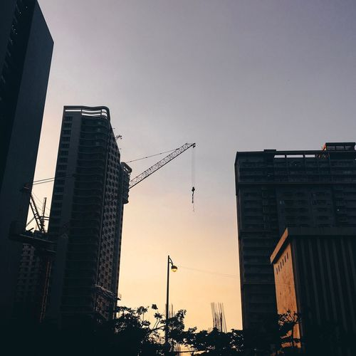 Low angle view of buildings against sky during sunset