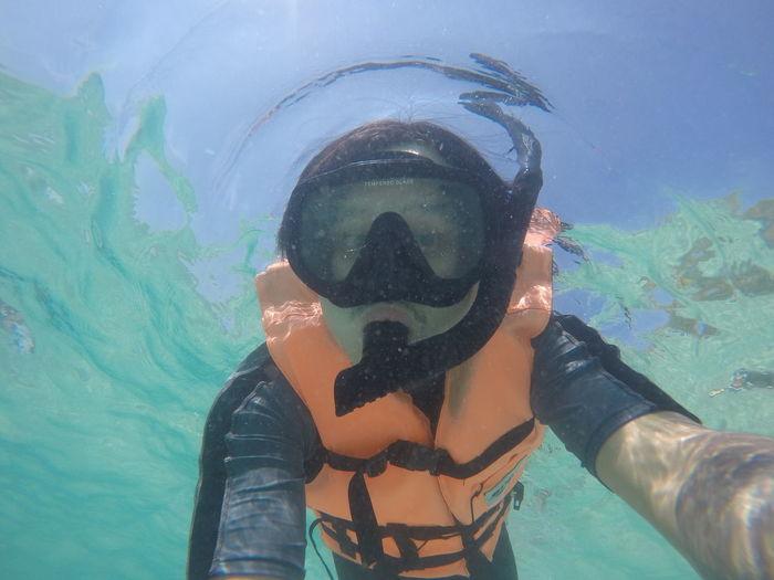 Portrait of man snorkeling undersea