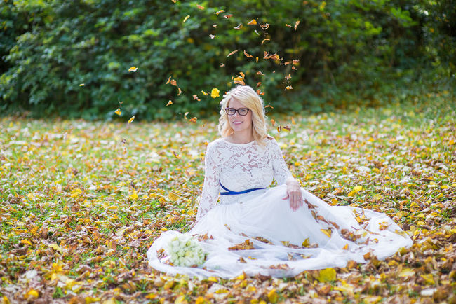 fantastically beautiful bride sitting in autumn leaves on their wedding day, women portrait on natural background, conquest of love Adult Adults Only Beautiful People Beautiful Woman Beauty Beauty In Nature Blond Hair Bride Day Glamour Human Body Part Nature One Person One Woman Only One Young Woman Only Only Women Outdoors People Portrait Serene People Smiling Wedding Dress Women Young Adult Young Women EyeEmNewHere Women Around The World