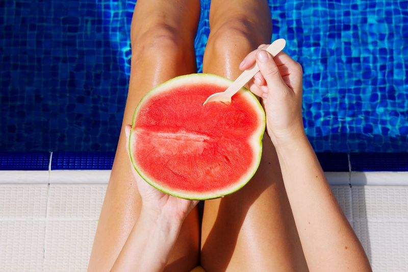 Eating watermelon by the pool Watermelon Pool Time Refreshment Summer Food Summertime Human Body Part One Person Women Swimming Pool Adult Body Part Red Summer Pool Vacations Leisure Activity Healthy Lifestyle Food And Drink Fruit