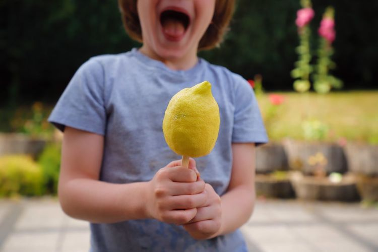 Midsection of boy holding ice cream