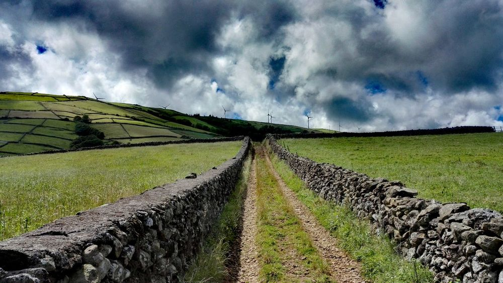 EyeEm Best Shots Cloud - Sky Vulcanic Landscape Terceira Stone Wall Outdoor Photography Showcase July Scenic Landscape Azoren Clouds And Sky Beautiful Day Hillside On The Way Diminishing Perspective Hiking Low Angle View EyeEm Best Shots - Nature Whataview EyeEm Gallery On A Hike Tourism Pathway