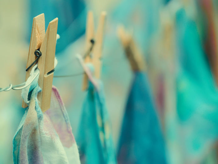 Close-up of clothespins hanging on clothesline