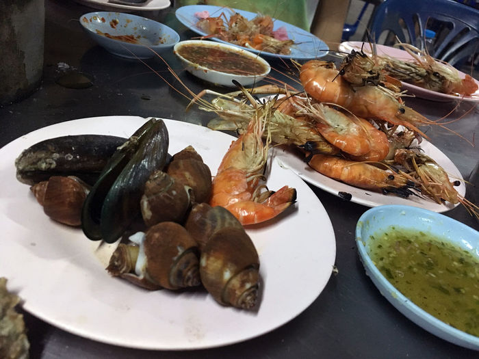 seafood Assorted delicious grilled. Restaurant Barbecue at the night market Close-up Closeup, Thailand, Meal, Table, Barbecue, Beef, Delicious, View, Buffet, Concept, Shellfish, Grill, Restaurant, Summer, Shrimp, Gourmet, Pork, Crab, Vegetable, Dinner, Tomato, Healthy, Grilled, Beach, Lunch, Fire, Cooked, Cuisine, Assorted, Background, Fr Day Food Food And Drink Freshness Healthy Eating High Angle View Indoors  Mussel No People Plate Prawn Ready-to-eat Seafood Serving Size Table