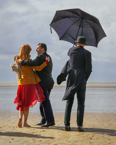 Another Singing Butler Water Rear View Real People Wet Two People Full Length Umbrella Protection Lifestyles Togetherness Standing Leisure Activity Adult Beach Rain Nature Men Land Outdoors Couple - Relationship Rainy Season