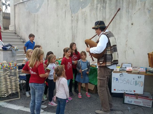 Capture The Moment, Bagpiper Street Musician Playing Music for Children. Traditional Instruments, Having Fun At The Fair, Listening To Music