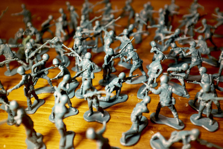 High angle view of army toys on hardwood floor