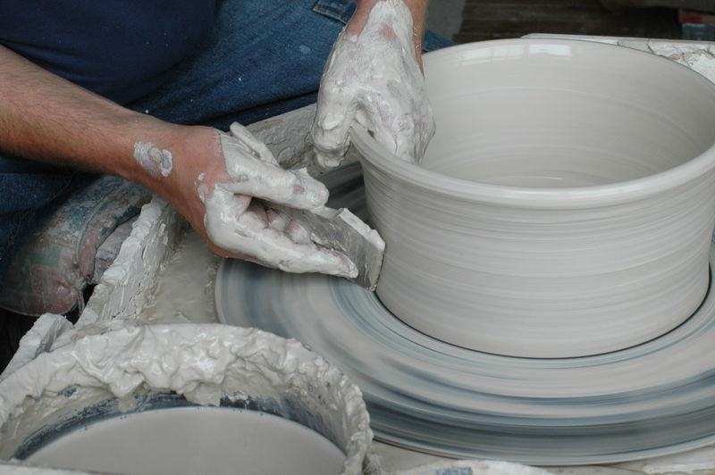 Midsection Of Man Making Pots