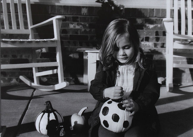Beautiful People Blackandwhite Casual Clothing EyeEm Gallery Film Filmphotography Focus On Foreground Girl Holding Kids Outside Person Play Pumpkin Sitting Toddler  Monochrome Monochrome Photography Fall Harvest Dots The Portraitist The Portraitist