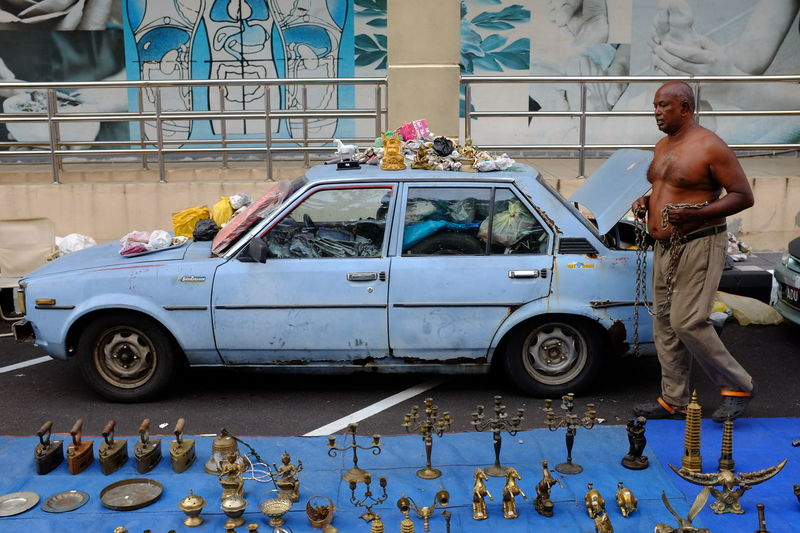 Art collector arranging his collection for sale at Loken Market, Ipoh. Loken market is a popular hunting ground for avid vintage item collectors. Auction Bum Car Boot Sale Chain Chair Collected Community Collection Collections Cool Cooper Dirty Garage Hello World Historic Iron Malaysia, Antiquity Russia Rustic Slum Streetphotography Trader