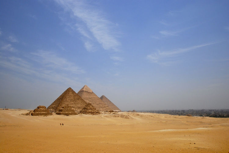 View of pyramids in desert against sky