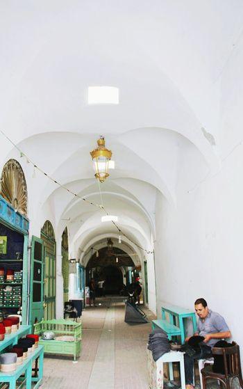 Man sitting in corridor