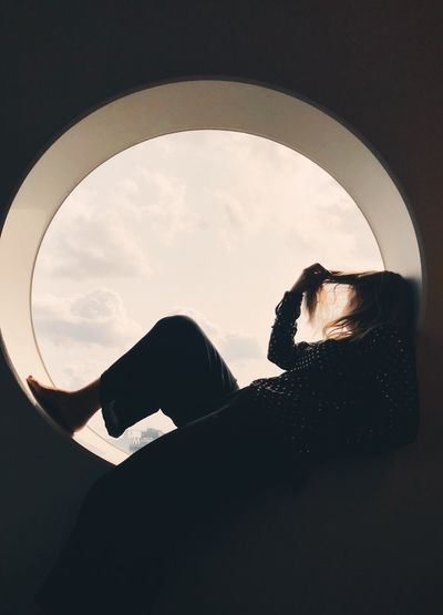 Sky Silhouette Real People One Person Nature Cloud - Sky Shape Geometric Shape Leisure Activity Lifestyles Window Day Circle Indoors  Arch Low Angle View Close-up Sitting
