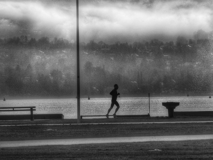 Lone runner Telling Stories Differently Black And White FUJIFILM X-T1 Streetphotography Urban Legend EyeEm Best Shots Streetphoto_bw Eye4photography  Black And White Photography Watching People Shootermag By The Lake Annecy, France In The Morning Runningman