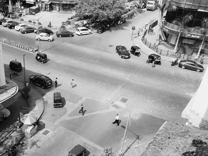 High Angle View Car Aerial View Outdoors Land Vehicle City Day People Road Street Mumbai City Cars Traffic Sub Urban Rickshaw Building Exterior Shadows City Light Politics And Government Built Structure Travel Destinations Large Group Of People Welcome To Black Mobility In Mega Cities
