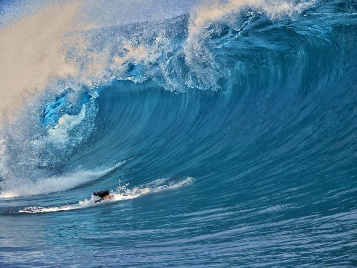 Low section of person surfing in sea