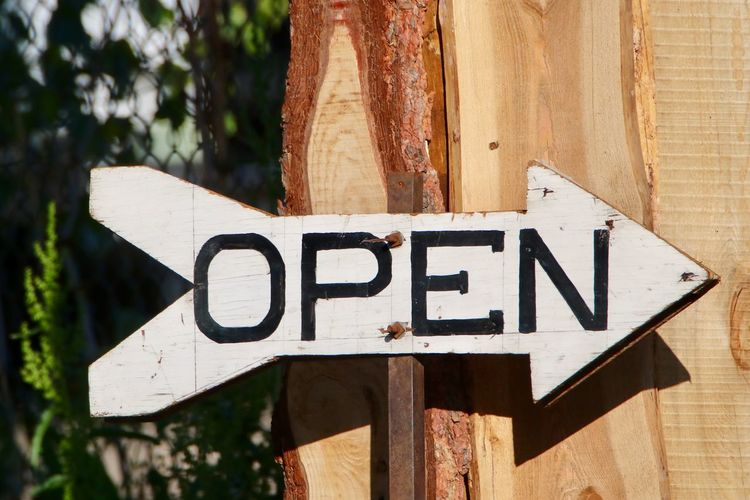 Arrow Arrow Sign Close-up Communication Day Guidance Nature No People Open Open Sign Outdoors Shop Signs Text Tree Western Script Wood - Material