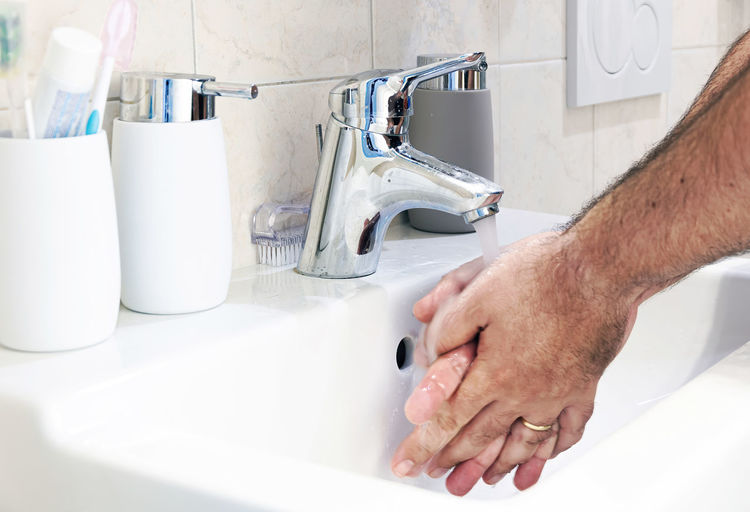 Midsection of man in bathroom at home