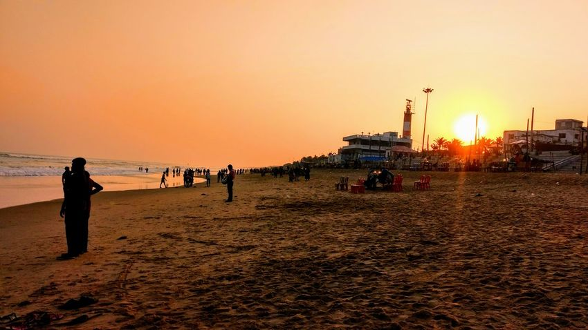 The shades of sunset Sunset Beach Sky Large Group Of People Sand People Vacations Adult Men Adults Only Only Men Outdoors Water Nature Day