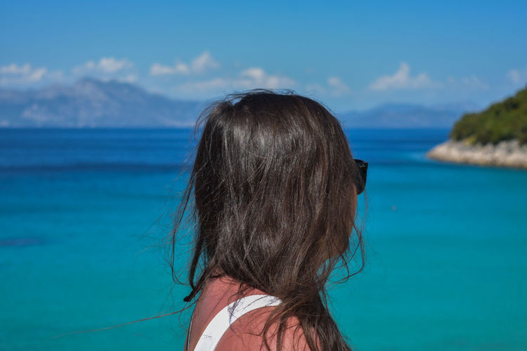 Close-up of woman standing against sea