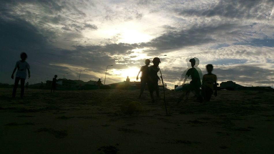 Kids in my hometown!!EyeEm Vietnam Kids Photography Kids Having Fun Kids Playing At The Beach Playing Football Twilight Sky My Hometown Sand And Sea EyeEm Kids November2015