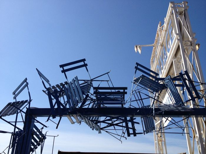 Low Angle View Of Structure Made Of Chairs