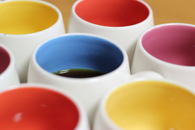 Close-up of multi colored cups