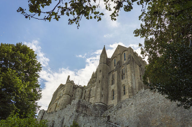 Church of Mont Saint Michel. outdoor view Architecture Branch Building Exterior Built Structure Castle Church Cloud - Sky Famous Place Fort France History Low Angle View Medieval Mont Saint-Michel No People Normandy Outdoors Place Of Worship Religion Sky Spire  Spirituality Steeple Tree