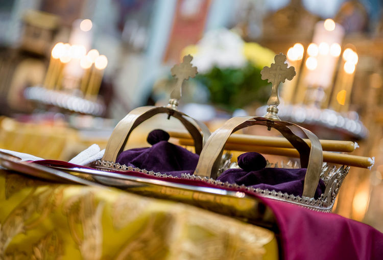 Close-Up Of Crowns On Table At Orthodox Wedding