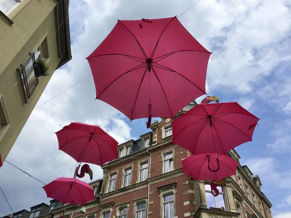 Architecture Building Building Exterior Built Structure City Cloud - Sky Day Hanging Low Angle View Multi Colored Nature No People Outdoors Protection Red Safety Security Sky Umbrella