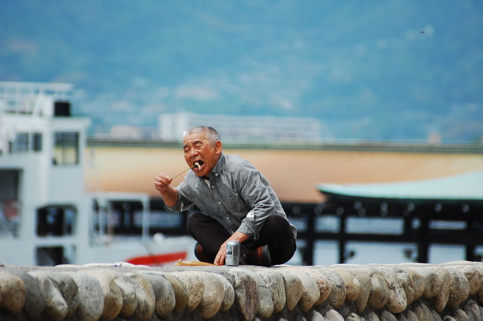 Japan Sushi Architecture Building Exterior Day Full Length Leisure Activity Lifestyles Lunchbreak Mature Adult One Person Outdoors People Real People Senior Adult Senior Men Sky Water Young Adult