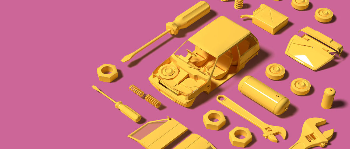 High angle view of toys on pink background