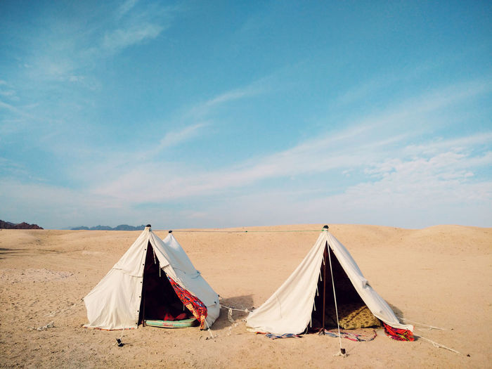 Tents At Desert Against Blue Sky