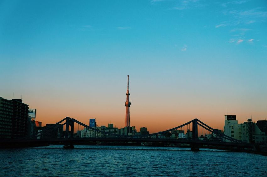 Japan 晴空塔 Built Structure City Architecture Tower Building Exterior Sunset Sky Travel Water Travel Destinations Outdoors Communication Waterfront No People Silhouette River Television Tower Cityscape Skyscraper Nature Sunset Bridge River