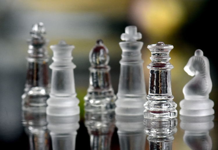 Chess Board Game Game Glass - Material Leisure Games Chess Piece Close-up Relaxation No People Still Life Indoors  Chess Board Arrangement Focus On Foreground Transparent Table Large Group Of Objects Leisure Activity Queen - Chess Piece Selective Focus King - Chess Piece Knight - Chess Piece Pawn - Chess Piece