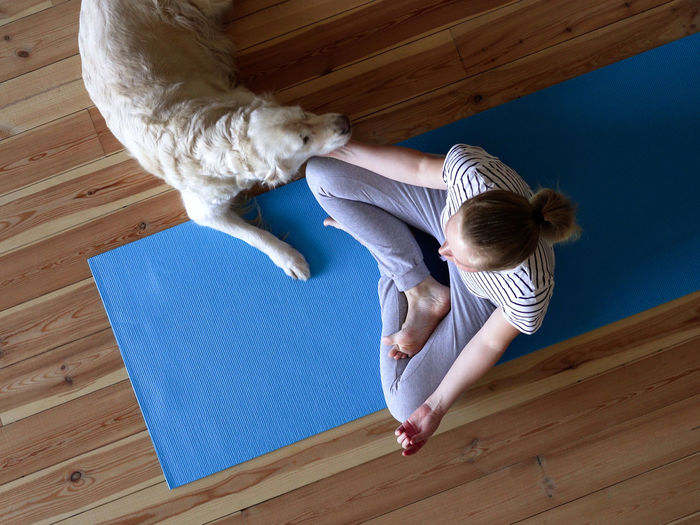 High angle view of girl on floor at home