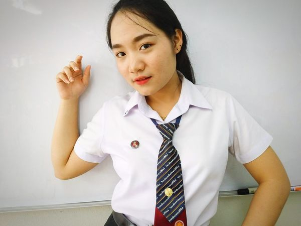 Business Finance And Industry Adults Only One Woman Only Only Women Women Indoors  Occupation One Young Woman Only Business Adult One Person People Front View Human Body Part Standing Human Hand Young Adult Day Portrait Confidence  Happiness Smiling Looking At Camera Office Presents