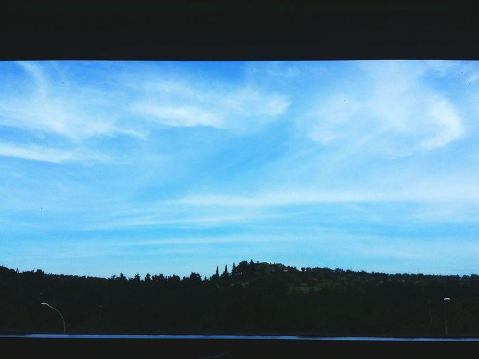 Road against blue sky