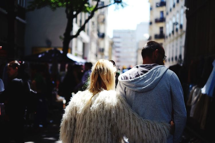 One in the light, One in the shade, but always together // Geneva Streetphotography Holiday POV Couple Portrait Of Strangers