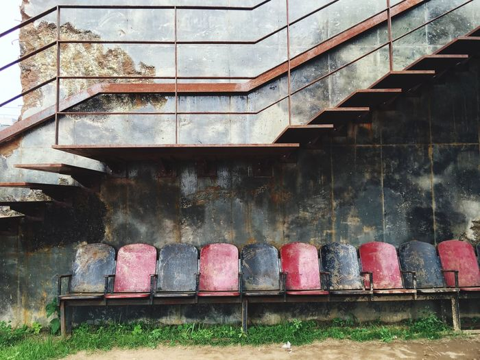Old Damaged Empty Chairs Against Steps