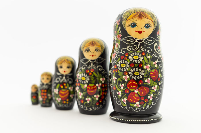 Beautiful painted black, red and white russian matryoshka dolls on white background Doll Painted Red Russia Tradition Travel Art And Craft Babushka Black Close-up Craft Culture Decoration Female Handmade Matreshka Matryoshka Nested Doll No People Russian Souvenir Studio Shot Tourism Toy White Background