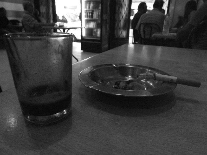 """Qahwa w'garoo khirmen sultan feedaroo"" A coffee and a cigarette, better than the sultan in his palace Coffee Weariness Ashtray  Black And White Cafeteria Close-up Day Drink Drinking Glass Enjoying Life Half Glass Full People Table"