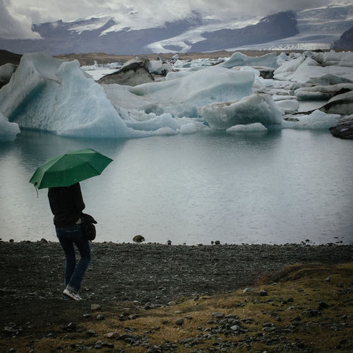 Beauty In Nature Day Frozen Ice Ice Floe Iceberg Iceland Iceland_collection Jökulsárlón Nature Nature One Person Outdoors Umbrella Water