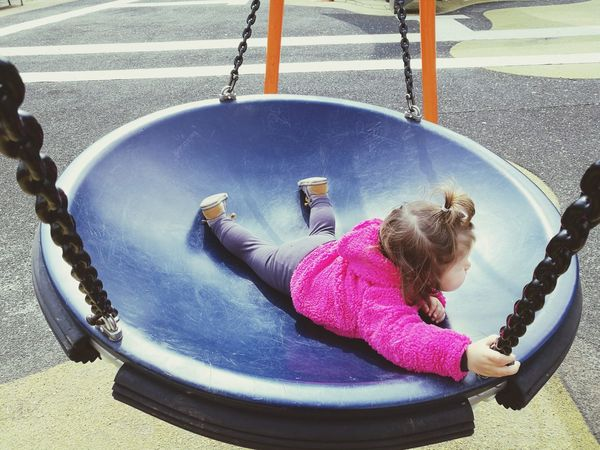 Toddler  Toddlerlife Toddler Girl Childhood Children Only One Child One Child Only Urban Lifestyle Child Playing Kid Playing Kids Being Kids Water Child Childhood Full Length Playing Smiling Outdoor Play Equipment Girls Fun Playground Merry-go-round Swing Rope Swing Chain Swing Ride Carousel Babyhood Slide - Play Equipment