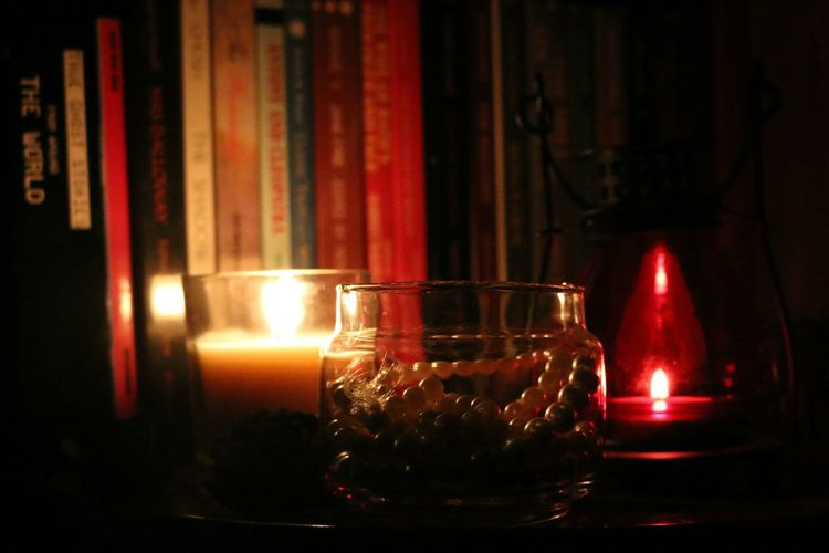Books, candle light, lamps and pearls~ elegant at it's peak! Glass - Material Indoors  Dark Close-up Flame Check This Out Flameshots Pearlsofwisdom Pearls Candlelight Candle Holder Lamps And Lighting Shadows & Lights Back Lightning Books Bookshelf Aromatherapy Scented Candle Elégance Tranquility Time To Relax Light Show PearlsAreBeautiful Welcome To Black Closeup Photography
